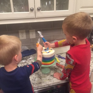 Kids decorating Daddy's cake